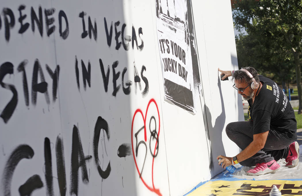 Manny Oliver works on a mural at a Road to Change Voter Registration Walk at Sunset Park in Las Vegas, Monday, July 16, 2018. The event was put on by the March For Our Lives group, created after t ...