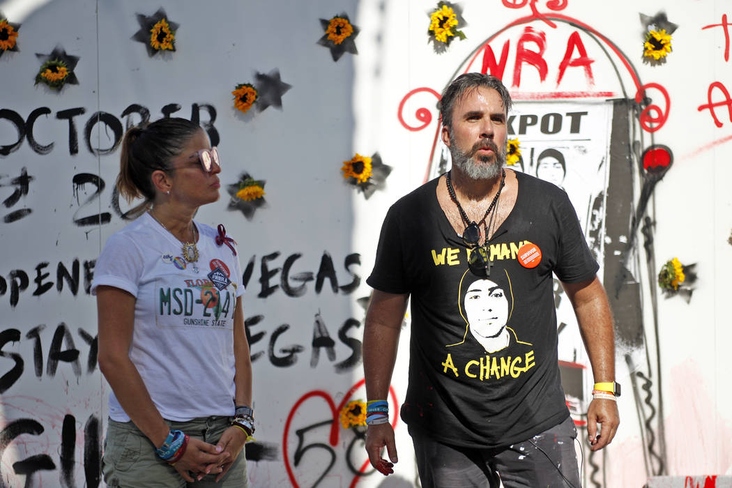 Manny Oliver, next to his wife Patricia Oliver, address the crowd after he painted a mural at a Road to Change Voter Registration Walk at Sunset Park in Las Vegas, Monday, July 16, 2018. The event ...