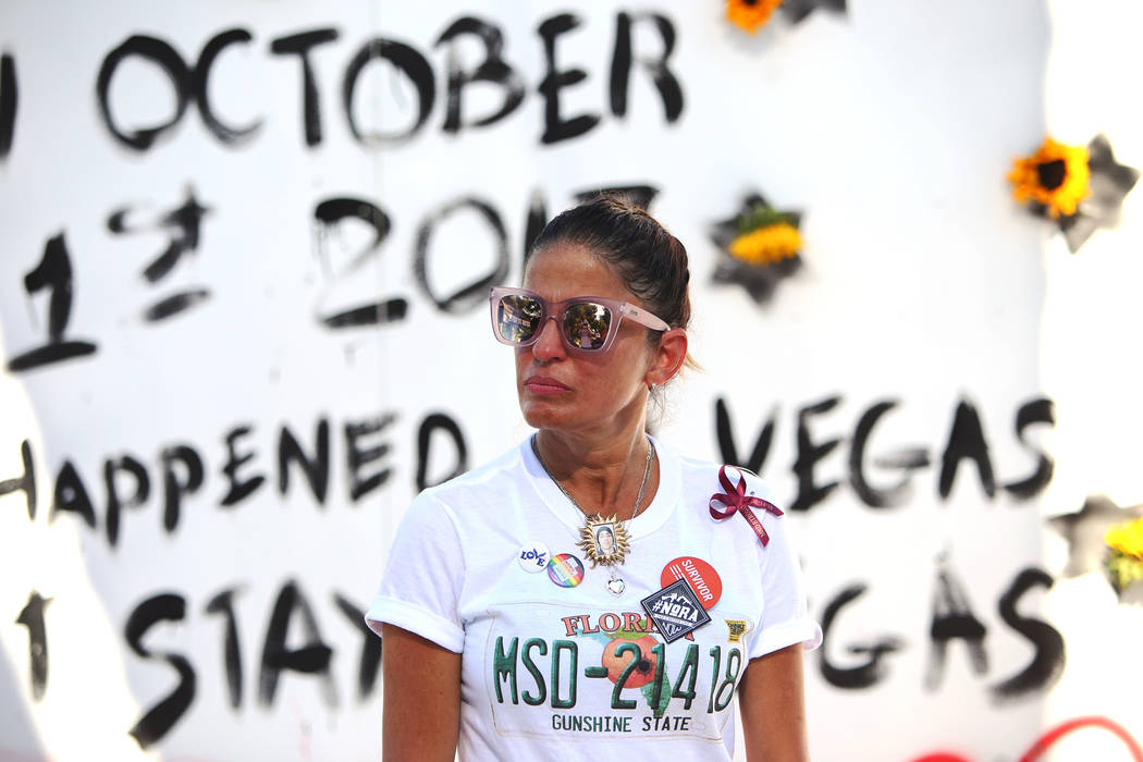 Patricia Oliver listens as her husband Manny Oliver address the crowd after he painted a mural at a Road to Change Voter Registration Walk at Sunset Park in Las Vegas, Monday, July 16, 2018. The e ...