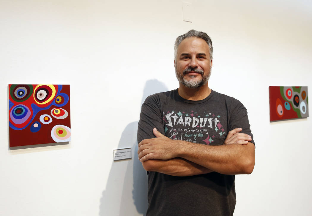 "The Las Vegas artist, Jerry Misko, poses for photo at The Studio at Sahara West Library where his art work is displayed for his show, ""Polyhedral"" on Monday, July 16, 2018, in Las Vegas. ..."