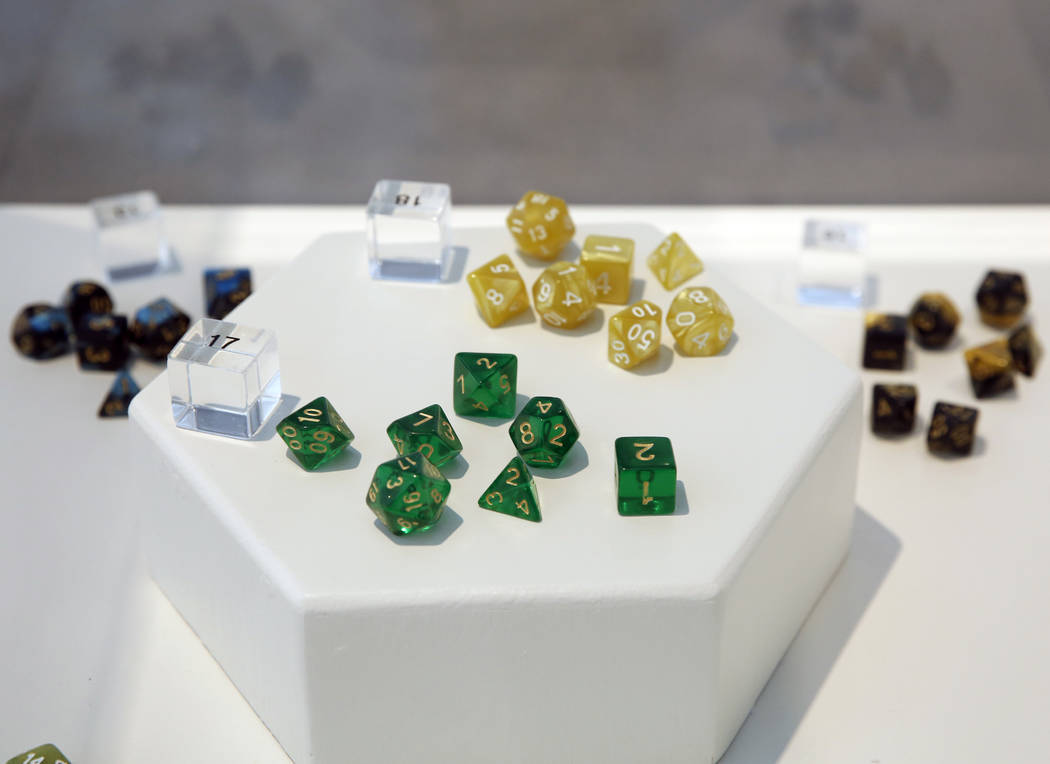 "Different colored polyhedral dice are displayed at the Las Vegas artist, Jerry Misko's show, ""Polyhedral"" at The Studio at Sahara West Library, on Monday, July 16, 2018, in Las Vegas. Bi ..."