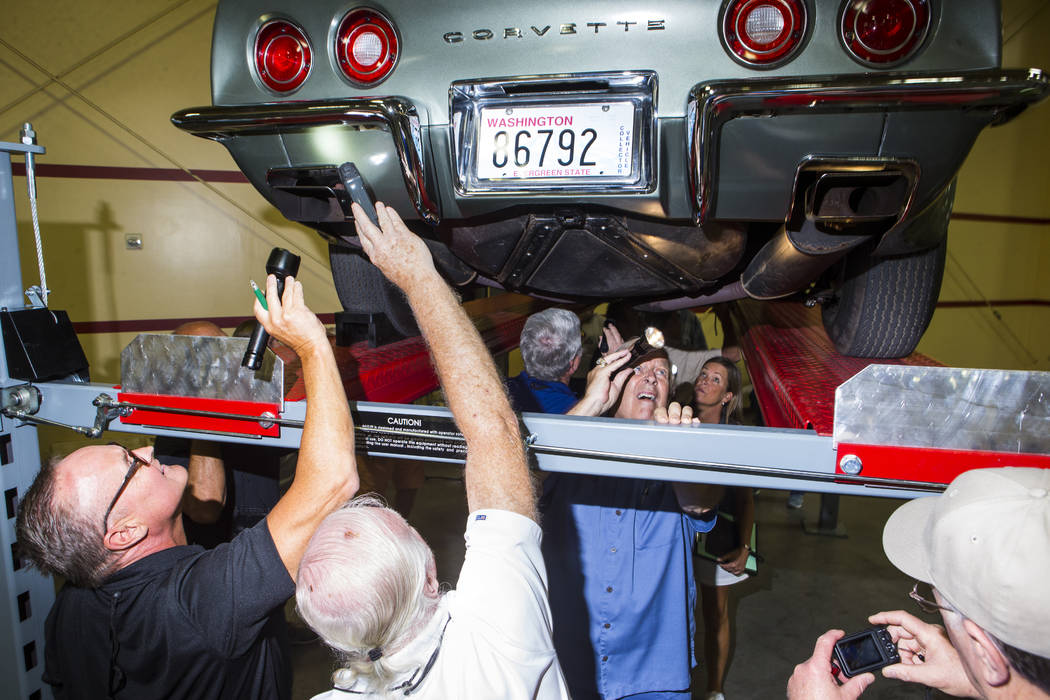 John Ballard, third from left, inspects a 1973 Corvette during the National Corvette Restorers Society convention at the South Point in Las Vegas on Tuesday, July 17, 2018. Chase Stevens Las Vegas ...