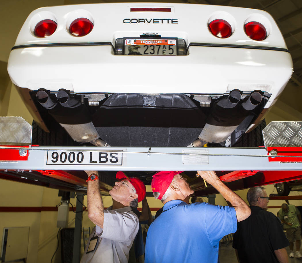 Don Troyer of Alhambra, Calif., left, and Ed Hoffman of Santa Clarita, Calif. inspect a 1988 Corvette during the National Corvette Restorers Society convention at the South Point in Las Vegas on T ...