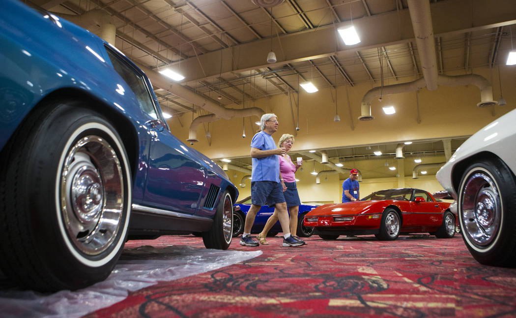Scott Balder and Jean Enright of Las Vegas walk past a blue 1967 Corvette owned by Hector Guzman during the National Corvette Restorers Society convention at the South Point in Las Vegas on Tuesda ...