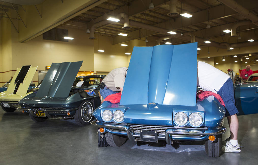 Attendees inspect a 1967 Corvette owned by Ray Geiger during the National Corvette Restorers Society convention at the South Point in Las Vegas on Tuesday, July 17, 2018. Chase Stevens Las Vegas R ...