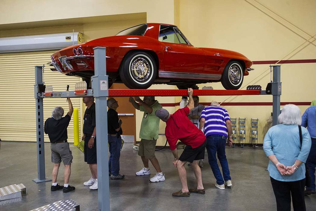 Attendees inspect a 1963 Corvette owned by Chris Moore during the National Corvette Restorers Society convention at the South Point in Las Vegas on Tuesday, July 17, 2018. Chase Stevens Las Vegas ...