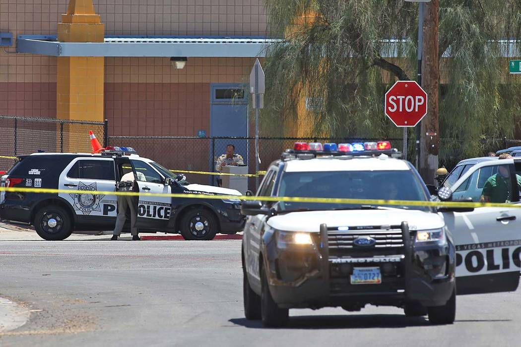 Members of the Metropolitan Police Department near Bruce and Ogden streets after an officer-involved shooting in Las Vegas, Wednesday, July 11, 2018. (Rachel Aston/Las Vegas Review-Journal) @rooki ...