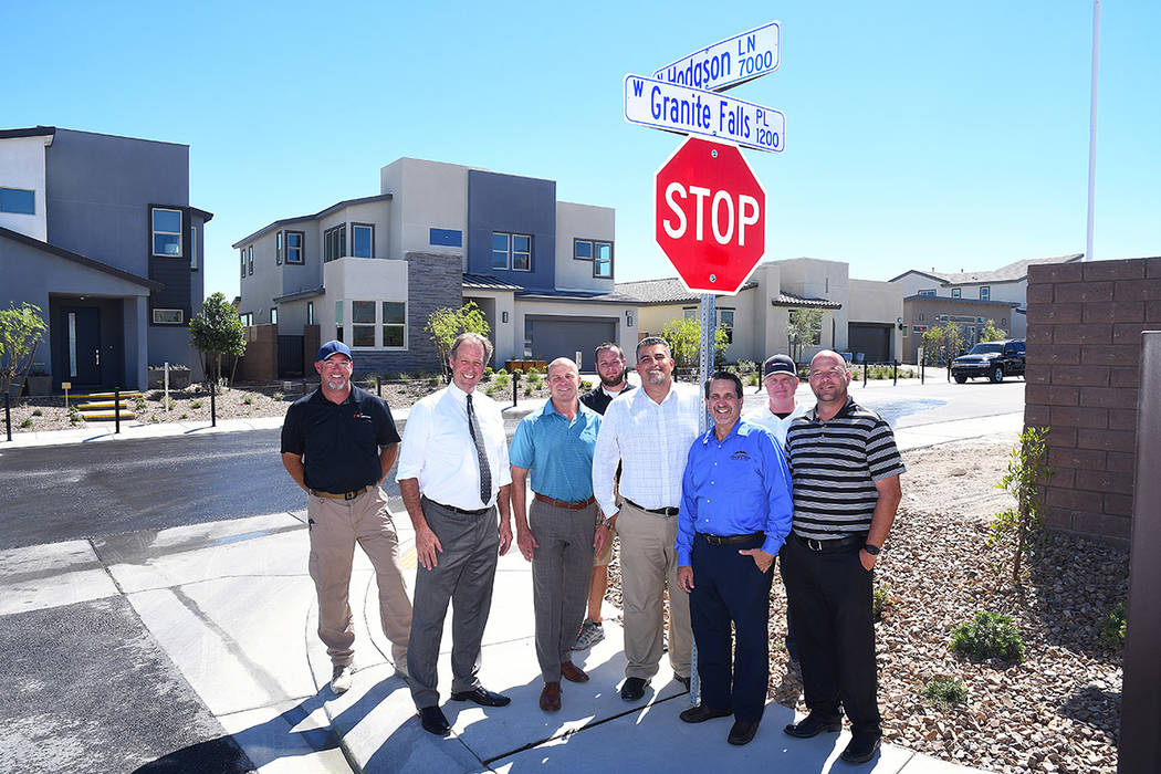 Pardee Homes dedicated Hodgson Lane at The Villages at Tule Springs in North Las Vegas. Pictured from left is Blackstone Construction Superintendent Michael Hudson, North Las Vegas Mayor John Lee, ...