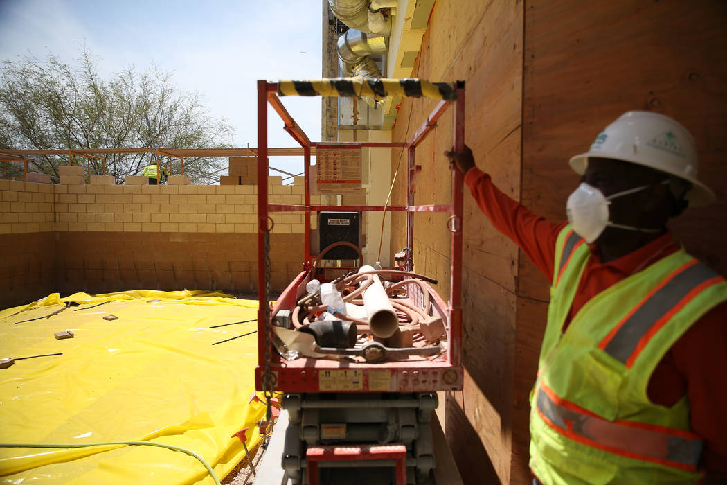 Chris Jones, project superintendent at Cora Coleman Senior Center, shows the construction site in Las Vegas, Tuesday, July 17, 2018. Renovations that include additional space are over 20 percent c ...