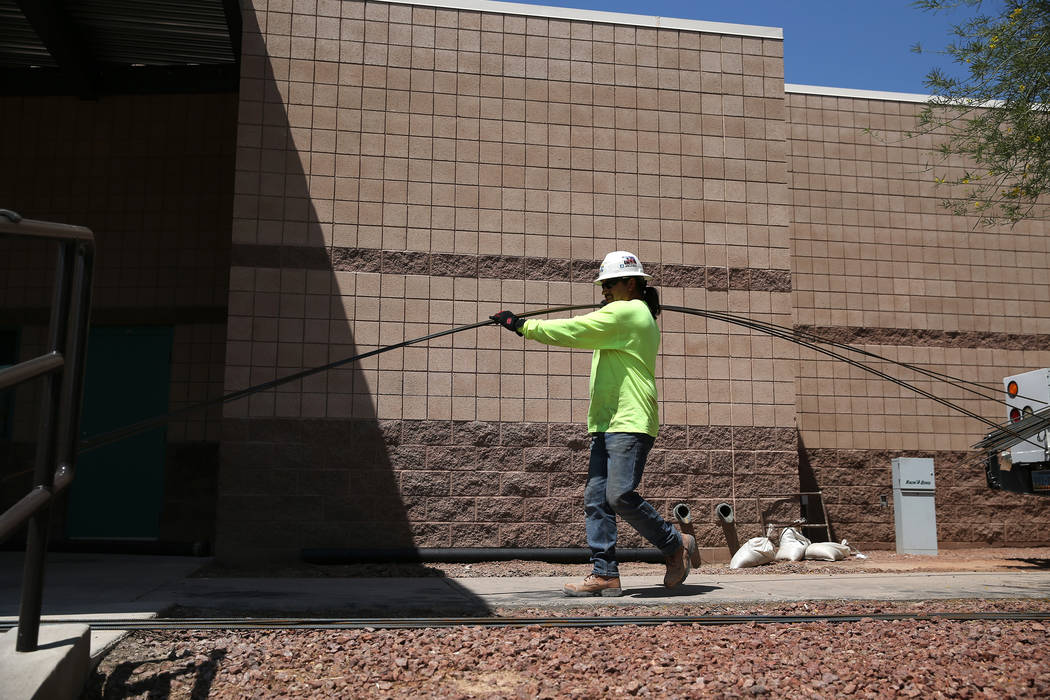 A construction worker carries equipment at Cora Coleman Senior Center in Las Vegas, Tuesday, July 17, 2018. Renovations that include additional space are over 20 percent complete at the senior cen ...