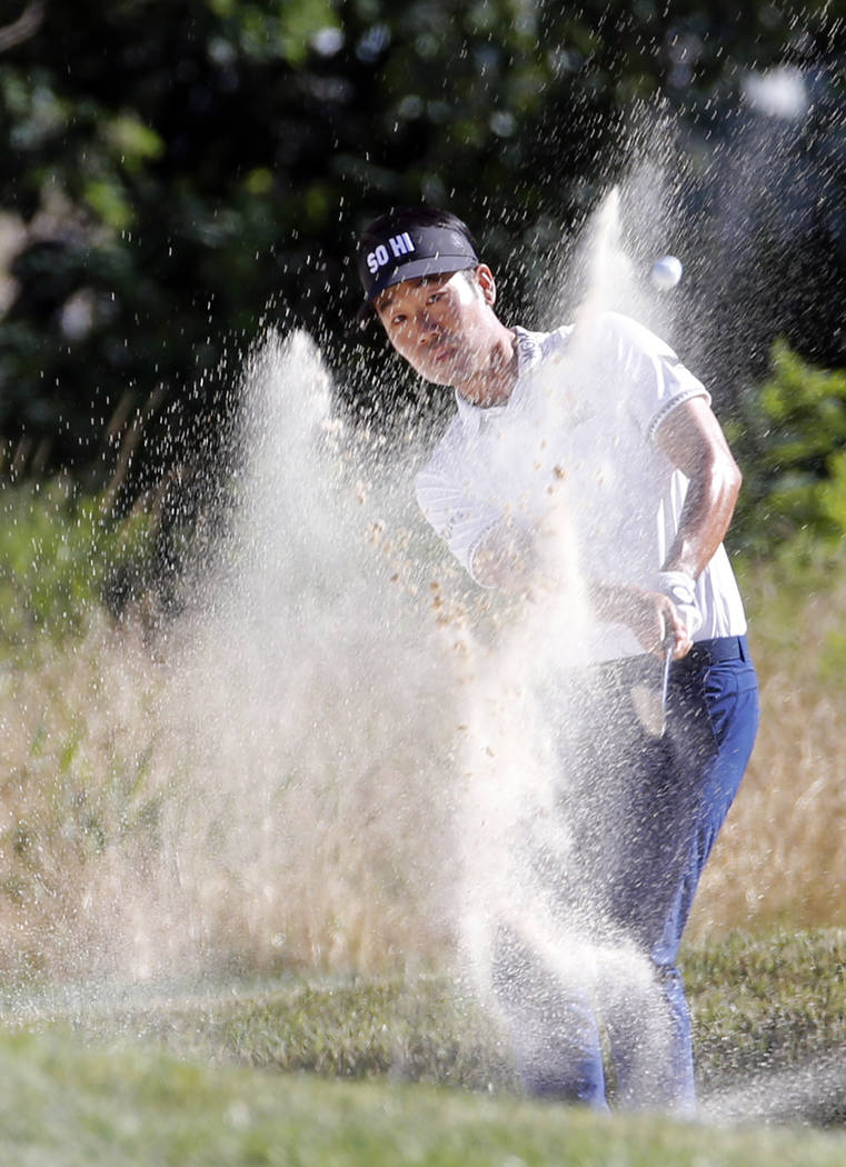 Kevin Na hits out of bunker on the 17th hole during the Military Tribute PGA Tour Golf Tournament at the Greenbrier in White Sulphur Springs, W. Va., Sunday, July 8, 2018. (AP Photo/Steve Helber)