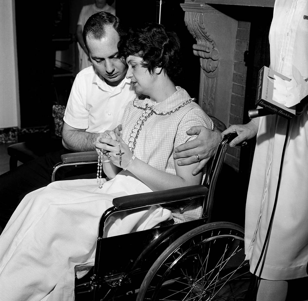 Fingering the rosary, Dora and Chester Fronczak are pictured as they pray for the return of their kidnapped son in Chicago, April 30, 1964. The couple then conducted a press conference. The son, P ...