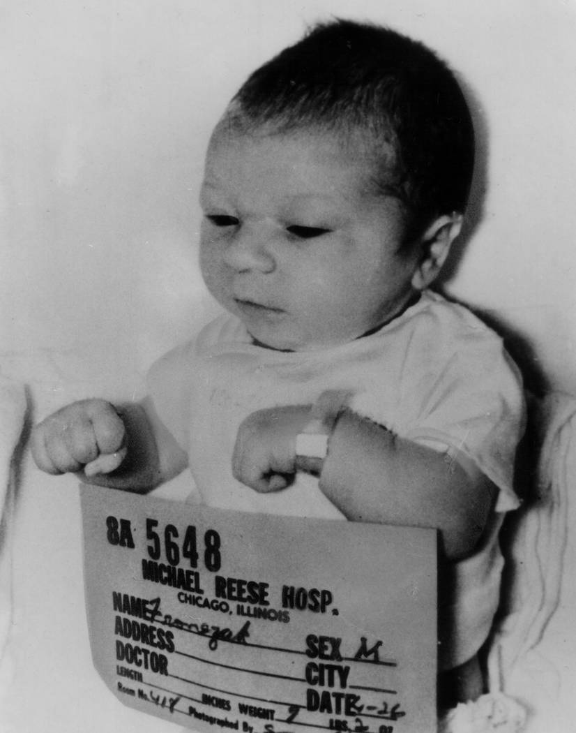 New-born Paul Joseph Fronczak is shown April 26, 1964, shortly after his birth at Michael Reese Hospital in Chicago. The baby was taken from his mother's arms by a woman dressed as a nurse who tol ...