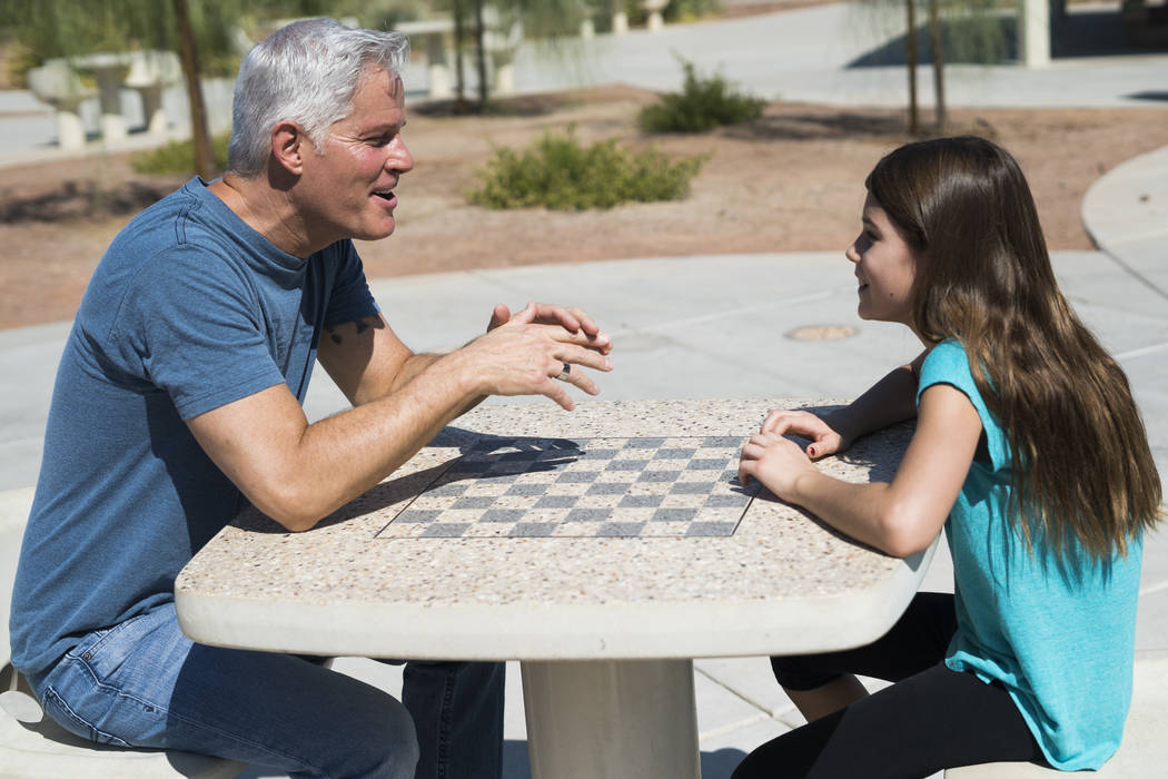 Paul Fronczak spends time with his daughter Emma at Paseo Vista Park in Henderson, Sunday, July 8, 2018. (Marcus Villagran/Las Vegas Review-Journal) @brokejournalist