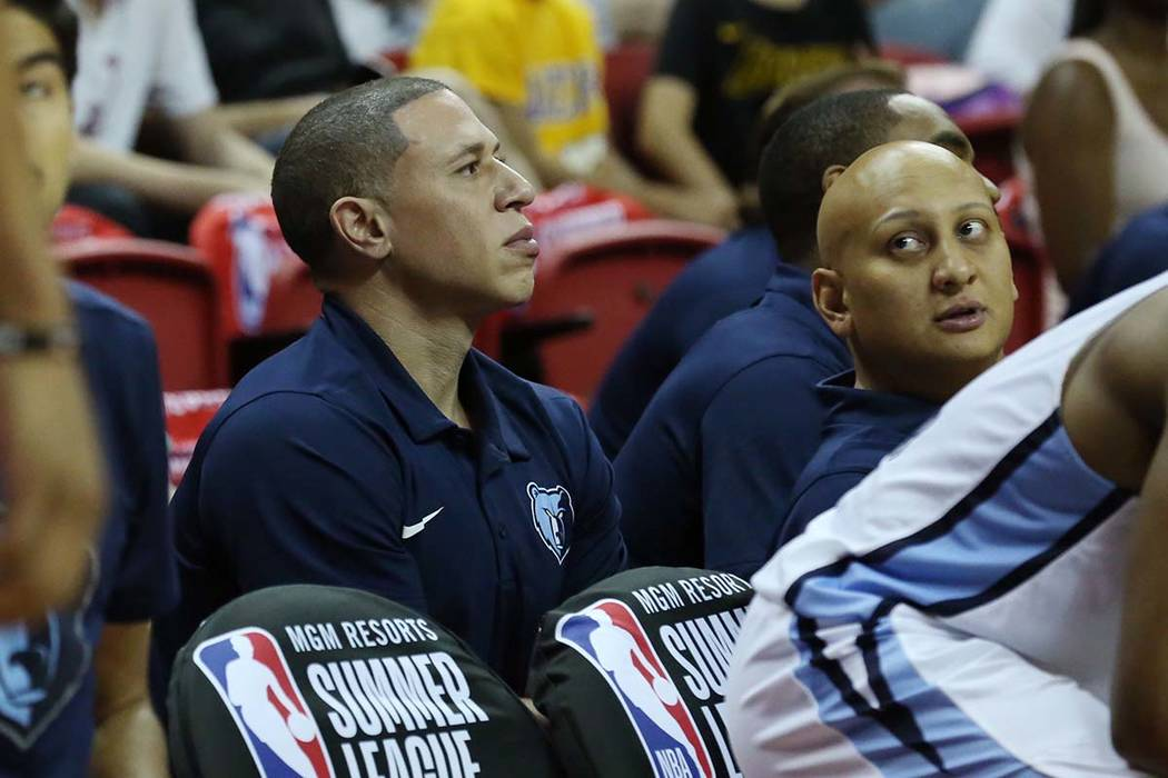 Mike Bibby, Memphis Grizzlies NBA Summer League coach, left, watches the game against the 76ers during an NBA Summer League basketball game at the Thomas and Mack Center on Sunday, July 15, 2018, ...