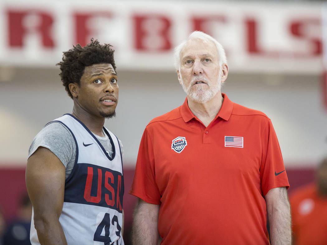 Head coach Gregg Popovich, right, works with Toronto Raptors guard Kyle Lowry (43) during Team USA basketball's minicamp on Thursday, July 26, 2018, at the Mendenhall Center, in Las Vegas. Benjami ...
