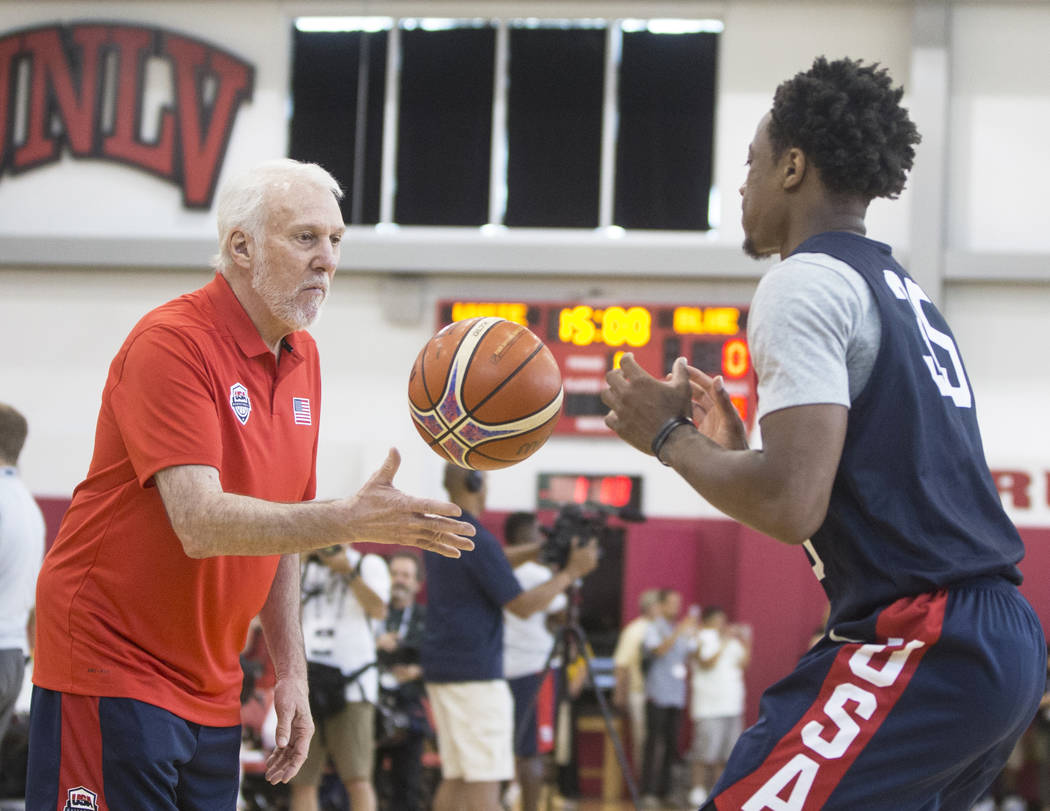 Head coach Gregg Popovich, left, works with San Antonio Spurs guard DeMar DeRozan (35) during Team USA basketball's minicamp on Thursday, July 26, 2018, at the Mendenhall Center, in Las Vegas. Ben ...