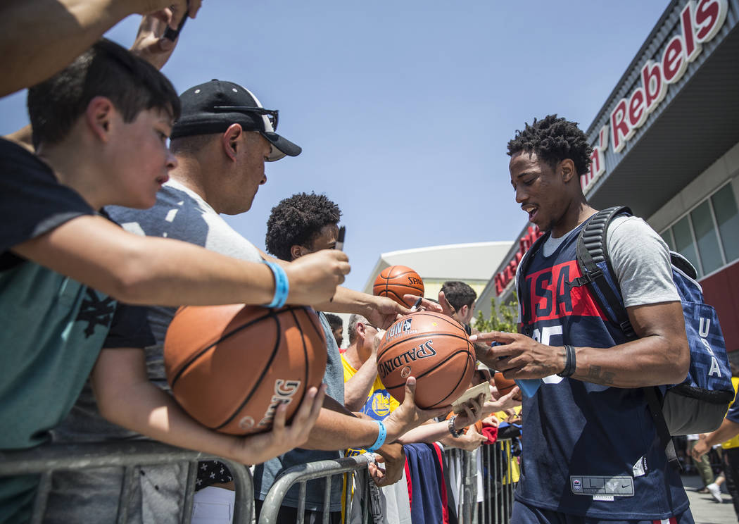 San Antonio Spurs guard DeMar DeRozan (35) signs autographs after Team USA basketball's minicamp on Thursday, July 26, 2018, at the Mendenhall Center, in Las Vegas. Benjamin Hager Las Vegas Review ...