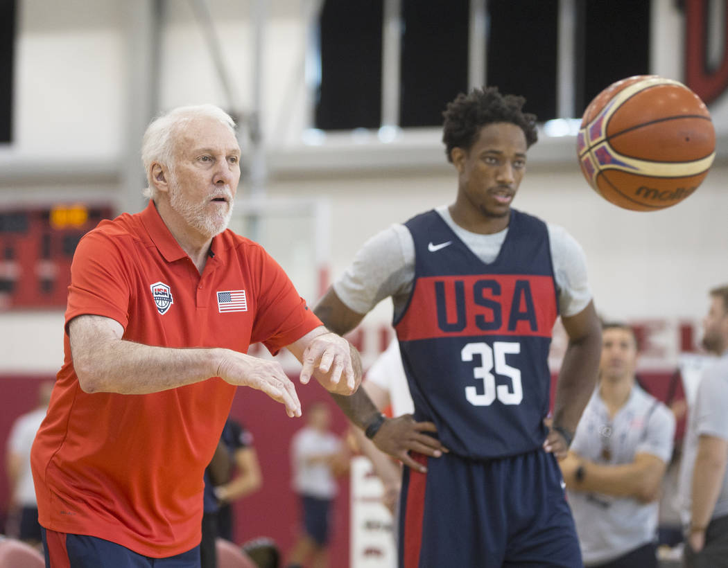 Head coach Gregg Popovich, left, and San Antonio Spurs guard DeMar DeRozan (35) work through drills during Team USA basketball's minicamp on Thursday, July 26, 2018, at the Mendenhall Center, in L ...