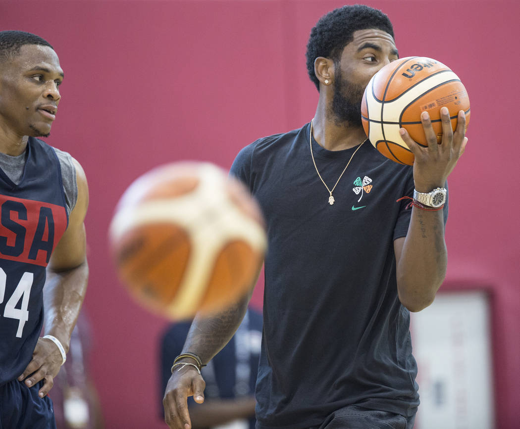 Oklahoma City Thunder guard Russell Westbrook (24) and Boston Celtics guard Kyrie Irving (37) joke around during Team USA basketball's minicamp on Thursday, July 26, 2018, at the Mendenhall Center ...