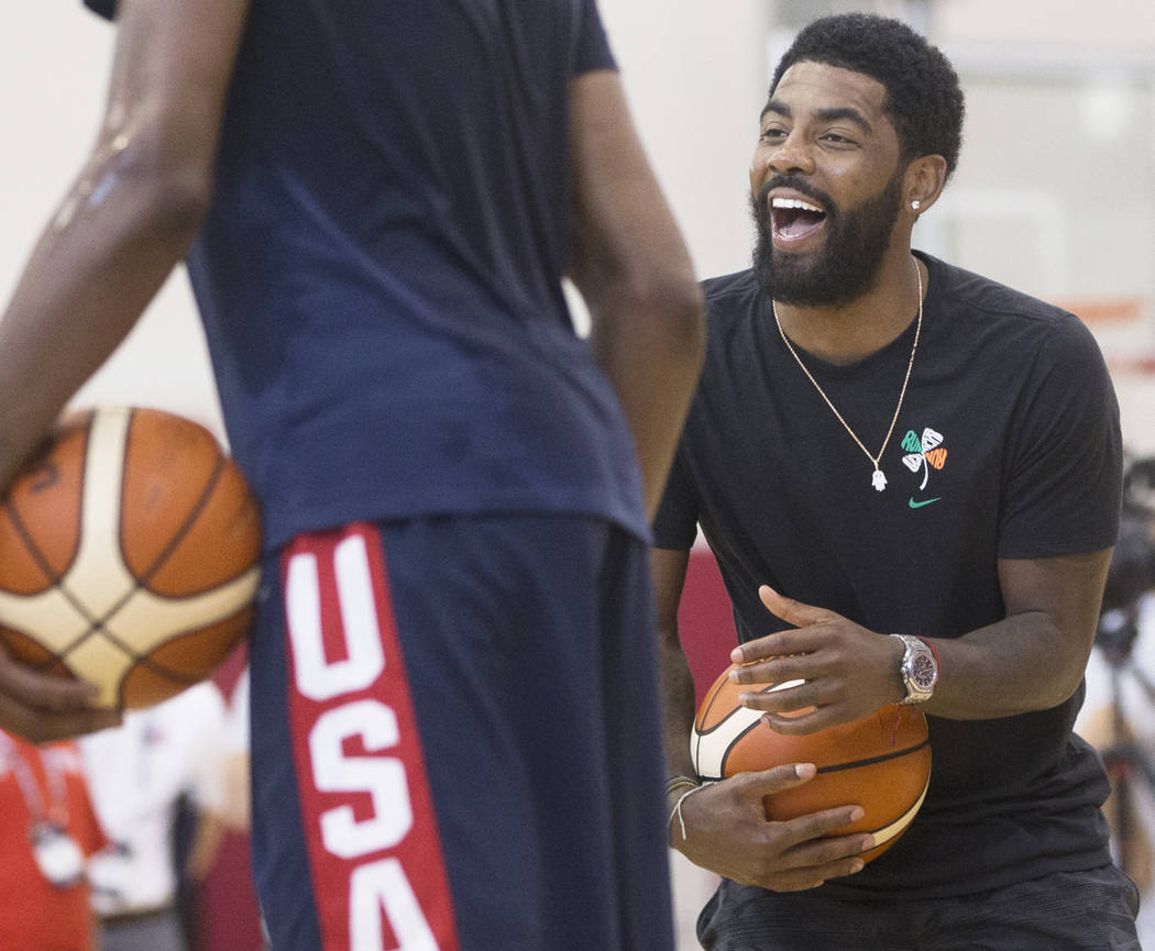 Boston Celtics guard Kyrie Irving (37) jokes around with teammates during Team USA basketball's minicamp on Thursday, July 26, 2018, at the Mendenhall Center, in Las Vegas. Benjamin Hager Las Vega ...