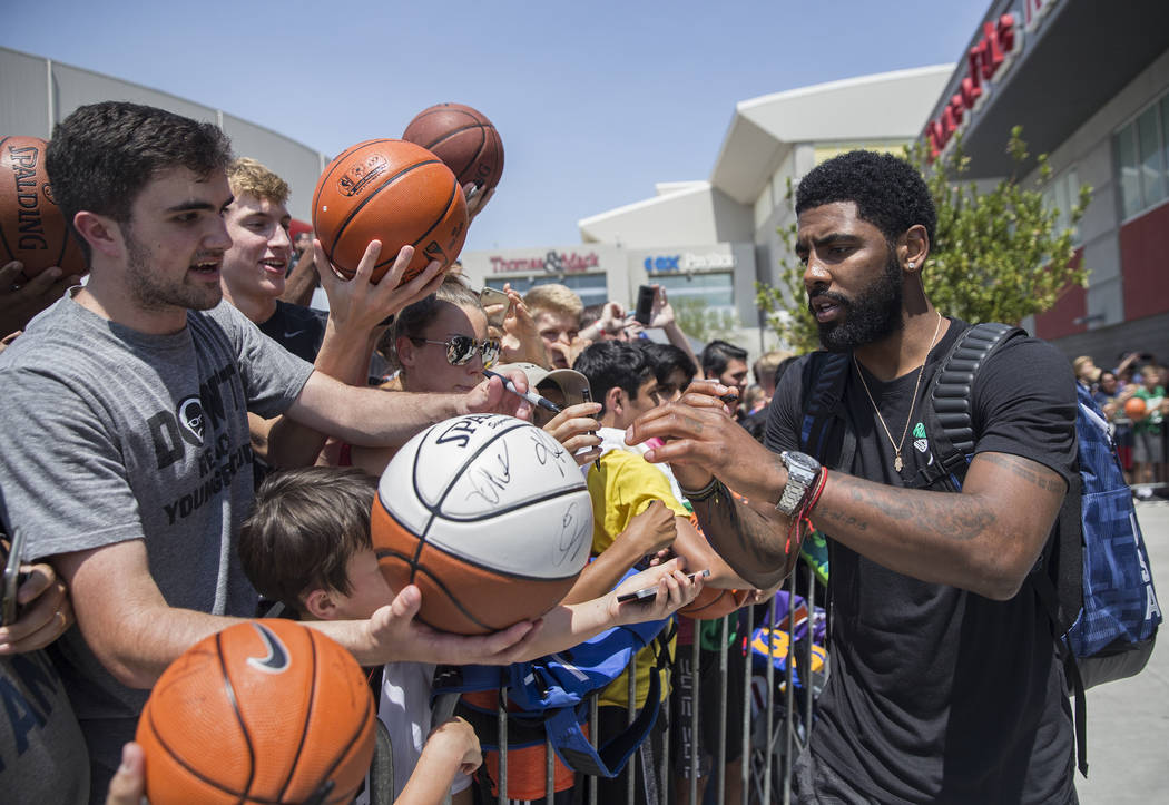 Boston Celtics guard Kyrie Irving (37) signs autographs after Team USA basketball's minicamp on Thursday, July 26, 2018, at the Mendenhall Center, in Las Vegas. Benjamin Hager Las Vegas Review-Jou ...