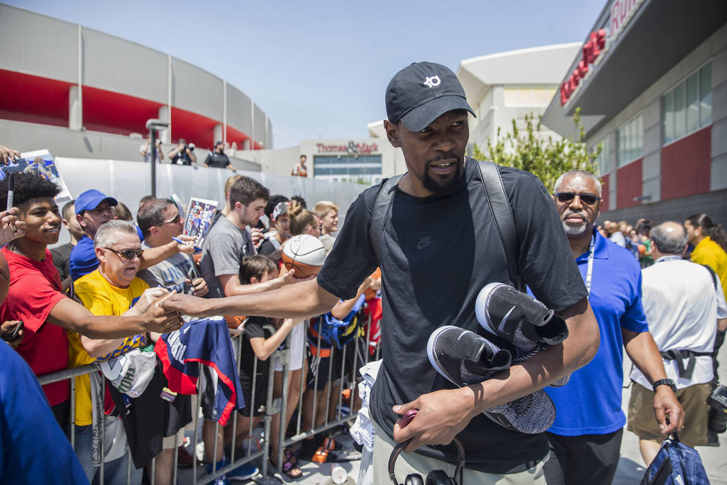 Golden State Warriors guard Kevin Durant (52) signs autographs after Team USA basketball's minicamp on Thursday, July 26, 2018, at the Mendenhall Center, in Las Vegas. Benjamin Hager Las Vegas Rev ...