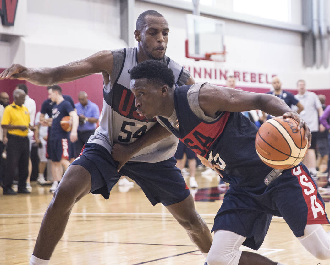 Indiana Pacers guard Victor Oladipo (55) drives past Milwaukee Bucks forward Khris Middleton (54) during Team USA basketball's minicamp on Friday, July 27, 2018, at the Mendenhall Center, in Las ...