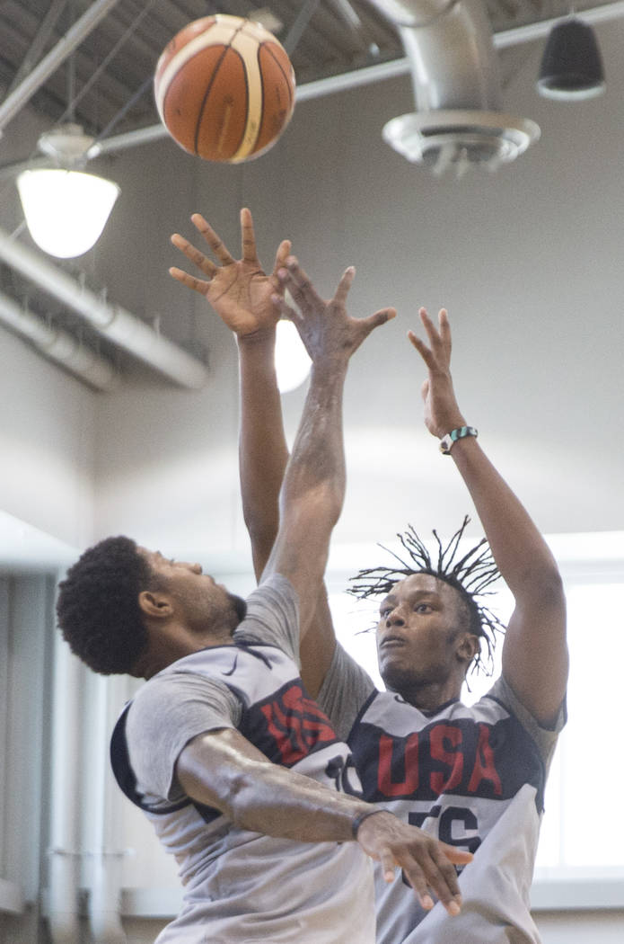 Indiana Pacers center Miles Turner (56) shoots over Oklahoma City Thunder forward Paul George (39) during Team USA basketball's minicamp on Friday, July 27, 2018, at the Mendenhall Center, in La ...