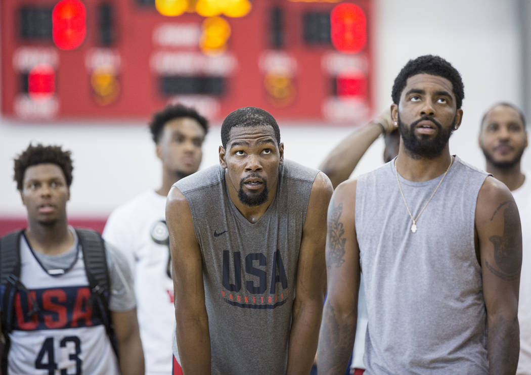 Golden State Warriors guard Kevin Durant (52) and Boston Celtics guard Kyrie Irving (37) watch practice during Team USA basketball's minicamp on Friday, July 27, 2018, at the Mendenhall Center, in ...