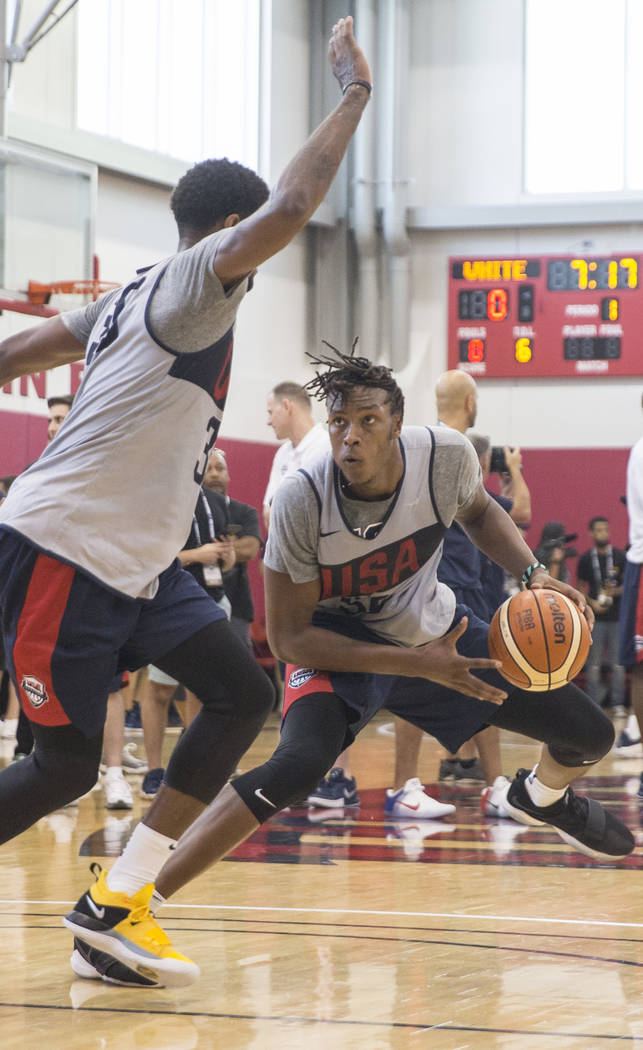 Indiana Pacers center Miles Turner (56) works against Oklahoma City Thunder forward Paul George (39) during Team USA basketball's minicamp on Friday, July 27, 2018, at the Mendenhall Center, in ...