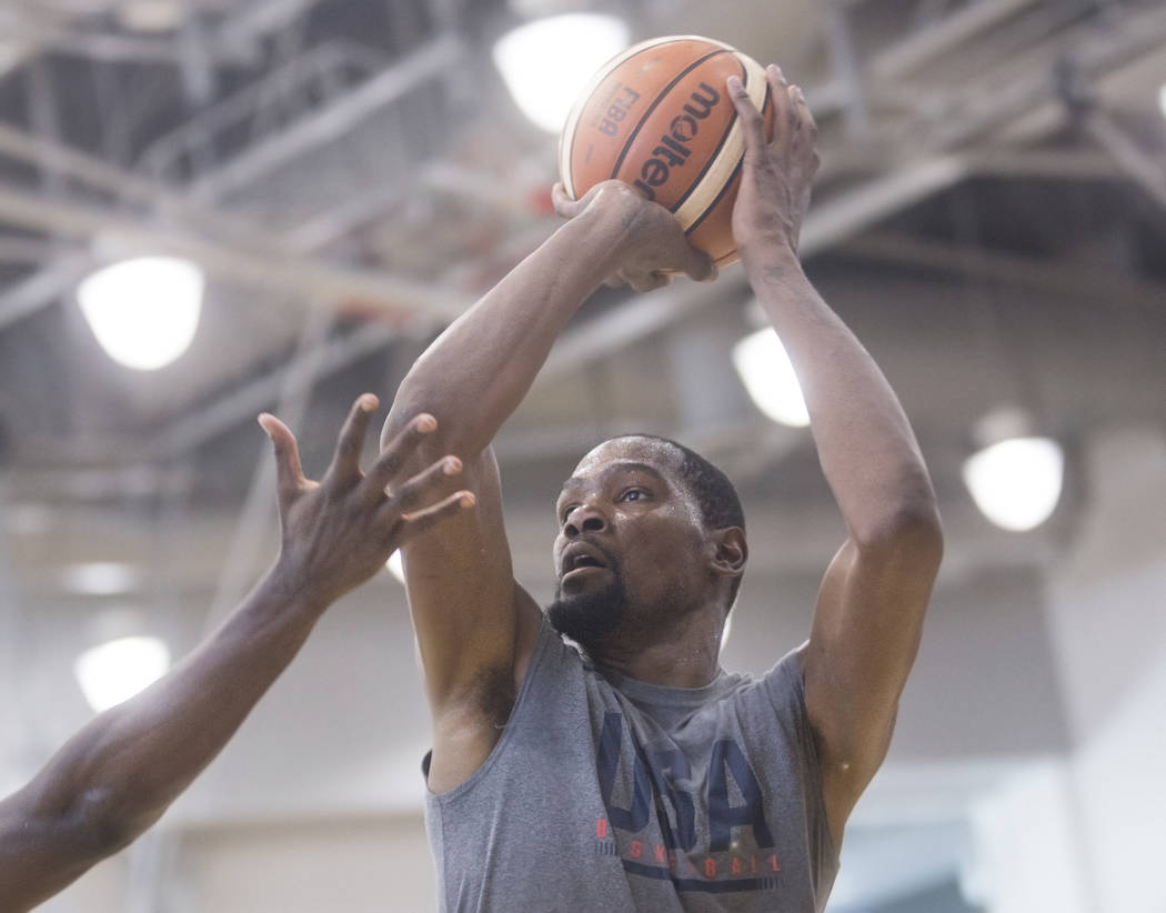 Golden State Warriors guard Kevin Durant (52) shoots three point shots during Team USA basketball's minicamp on Friday, July 27, 2018, at the Mendenhall Center, in Las Vegas. Benjamin Hager Las V ...