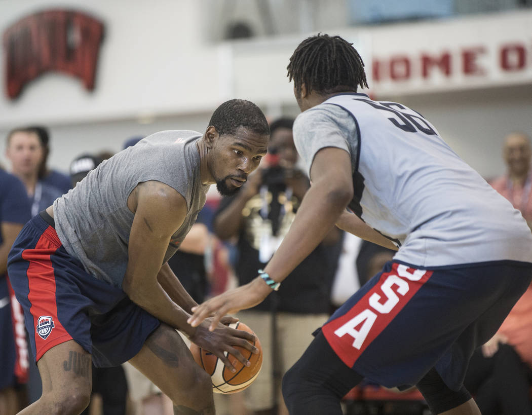 Golden State Warriors guard Kevin Durant (52) works against Indiana Pacers center Miles Turner (56) during Team USA basketball's minicamp on Friday, July 27, 2018, at the Mendenhall Center, in Las ...