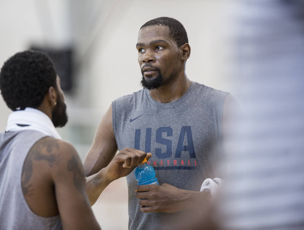 Golden State Warriors guard Kevin Durant (52) talks with teammates during Team USA basketball's minicamp on Friday, July 27, 2018, at the Mendenhall Center, in Las Vegas. Benjamin Hager Las Vegas ...