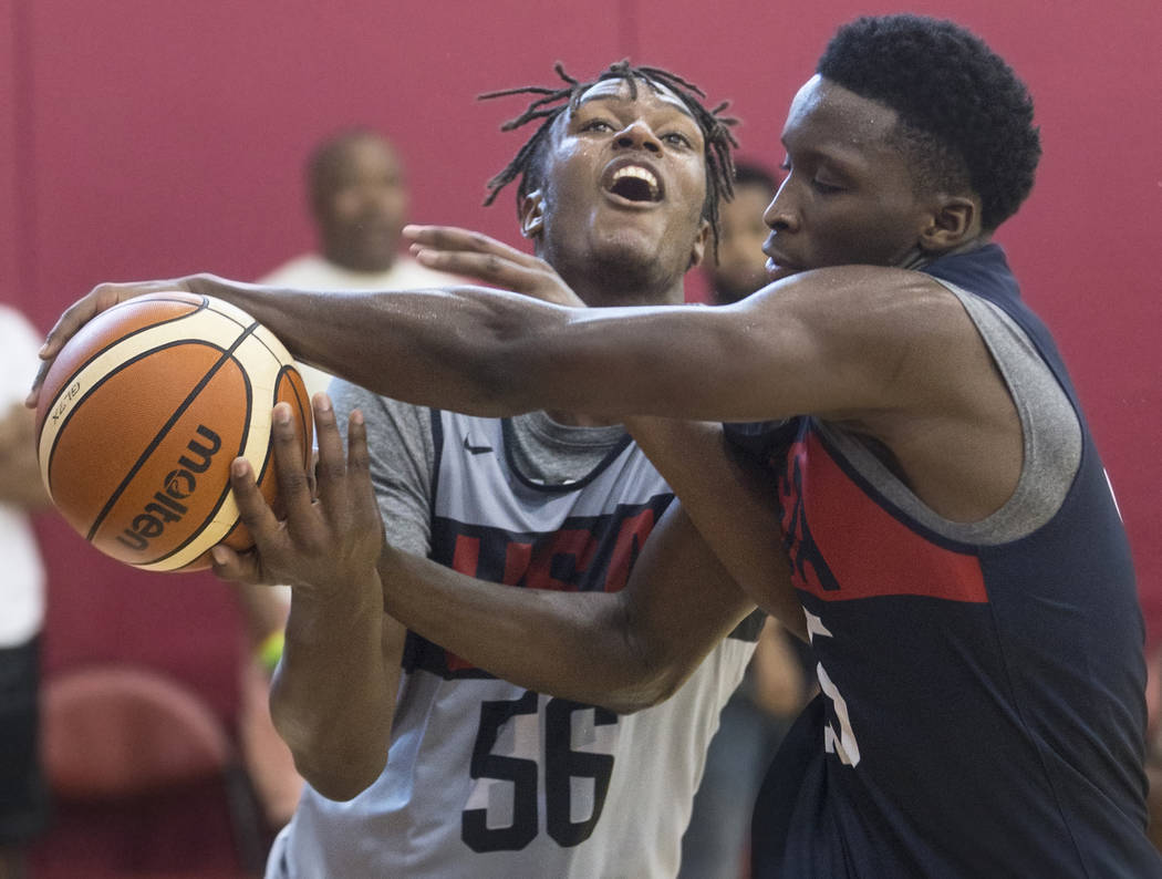 Indiana Pacers center Miles Turner (56) gets tied up with fellow Pacer Victor Oladipo (55) during Team USA basketball's minicamp on Friday, July 27, 2018, at the Mendenhall Center, in Las Vegas. B ...