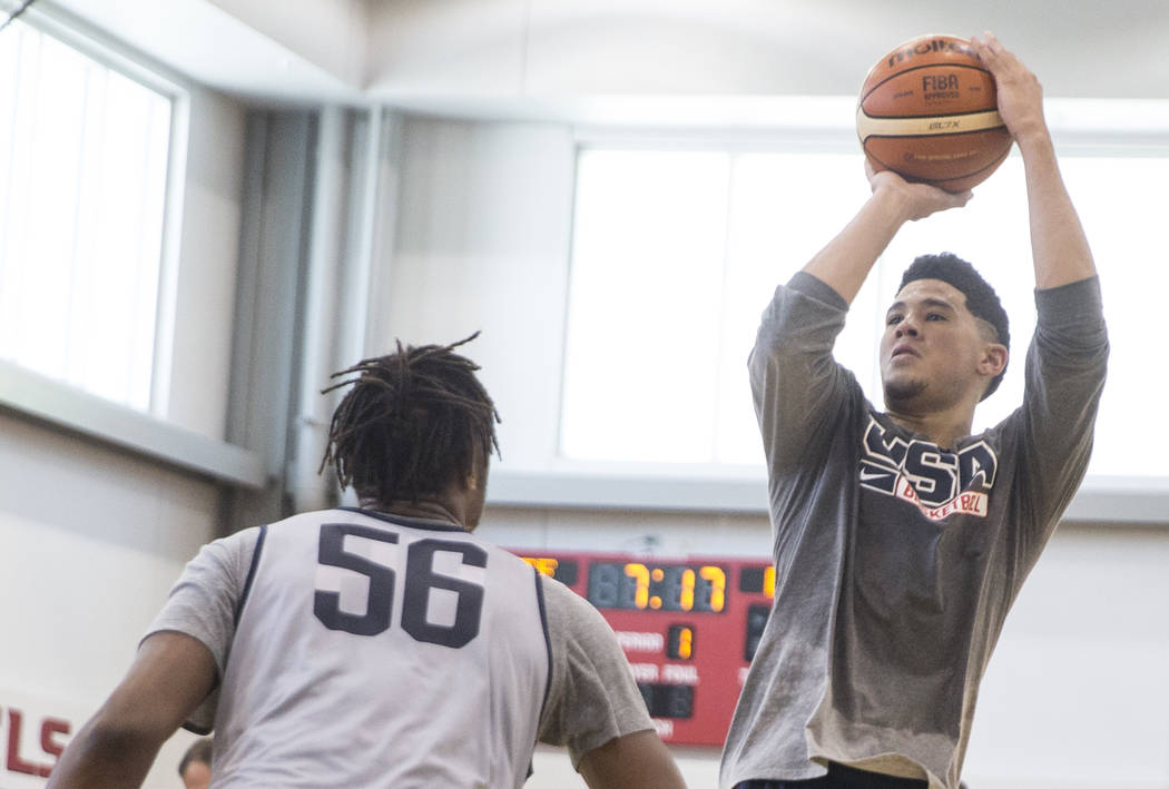 Phoenix Suns guard Devin Booker (31) shoots over Indiana Pacers center Miles Turner (56) during Team USA basketball's minicamp on Friday, July 27, 2018, at the Mendenhall Center, in Las Vegas. Ben ...