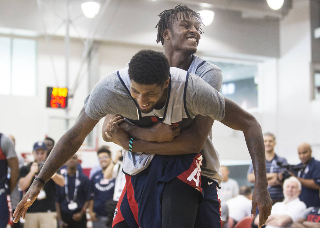 Indiana Pacers center Miles Turner (56) jokes around with Oklahoma City Thunder forward Paul George (39) during Team USA basketball's minicamp on Friday, July 27, 2018, at the Mendenhall Center, i ...