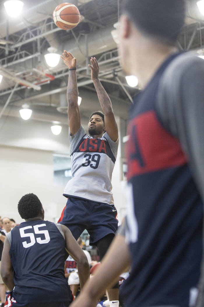 Oklahoma City Thunder forward Paul George (39) shoots over Indiana Pacers guard Victor Oladipo (55) during Team USA basketball's minicamp on Friday, July 27, 2018, at the Mendenhall Center, in Las ...