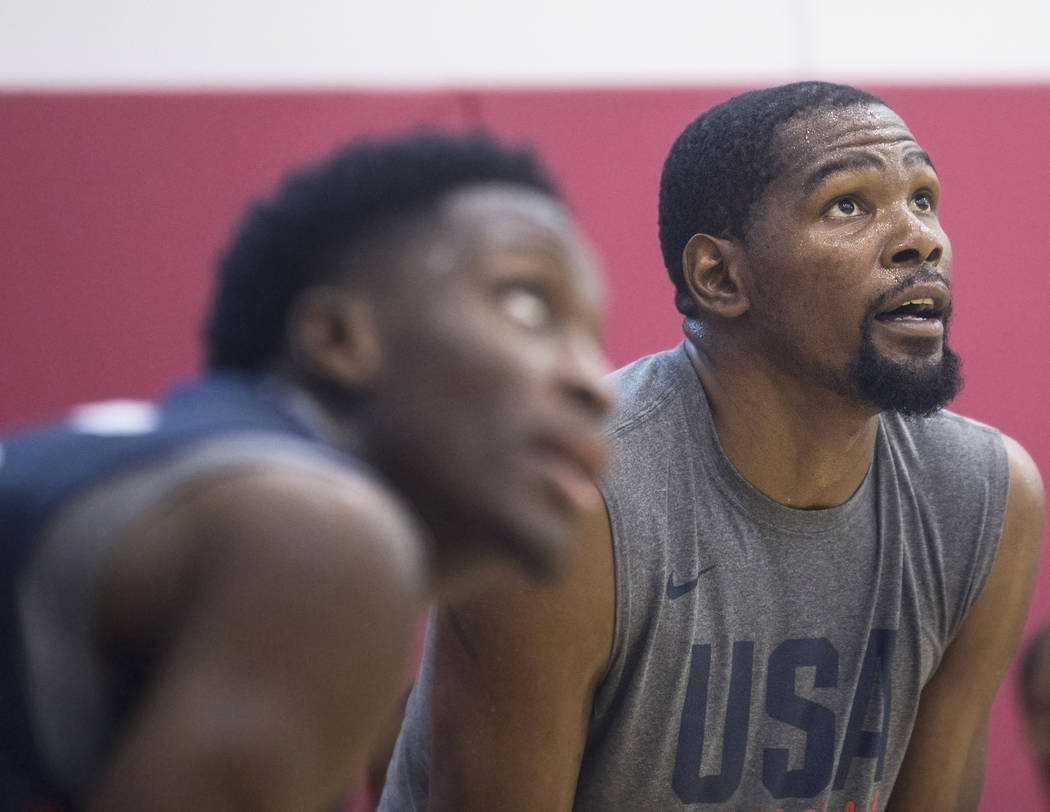 Golden State Warriors guard Kevin Durant (52) and Indiana Pacers guard Victor Oladipo (55) watch drills during Team USA basketball's minicamp on Friday, July 27, 2018, at the Mendenhall Center, i ...