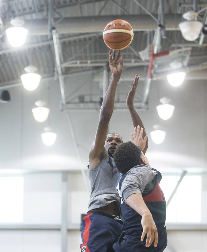 Golden State Warriors guard Kevin Durant (52) shoots over Phoenix Suns guard Devin Booker (31) during Team USA basketball's minicamp on Friday, July 27, 2018, at the Mendenhall Center, in Las Vega ...