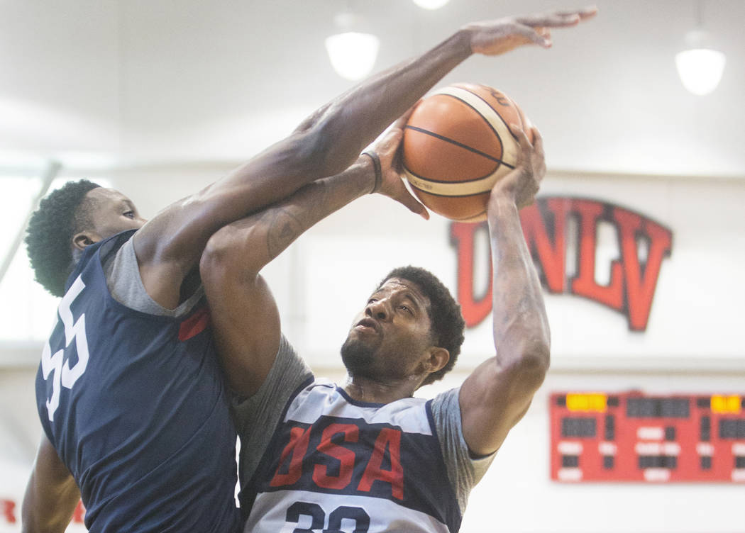 Oklahoma City Thunder forward Paul George (39) drives baseline on Indiana Pacers guard Victor Oladipo (55) during Team USA basketball's minicamp on Friday, July 27, 2018, at the Mendenhall Center, ...