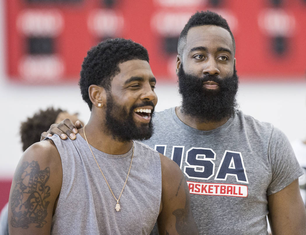 Boston Celtics guard Kyrie Irving (37) and Houston Rockets guard James Harden (47) joke around during Team USA basketball's minicamp on Friday, July 27, 2018, at the Mendenhall Center, in Las Vega ...