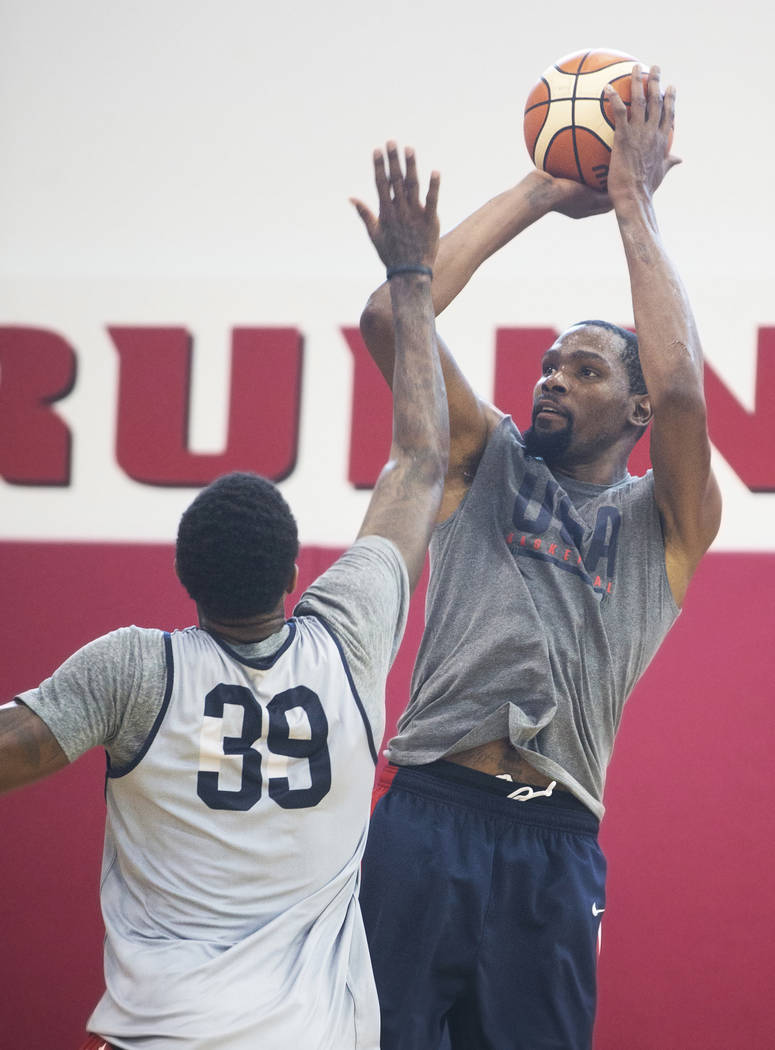 Golden State Warriors guard Kevin Durant (52) shoots over Oklahoma City Thunder forward Paul George (39) during Team USA basketball's minicamp on Friday, July 27, 2018, at the Mendenhall Center, i ...