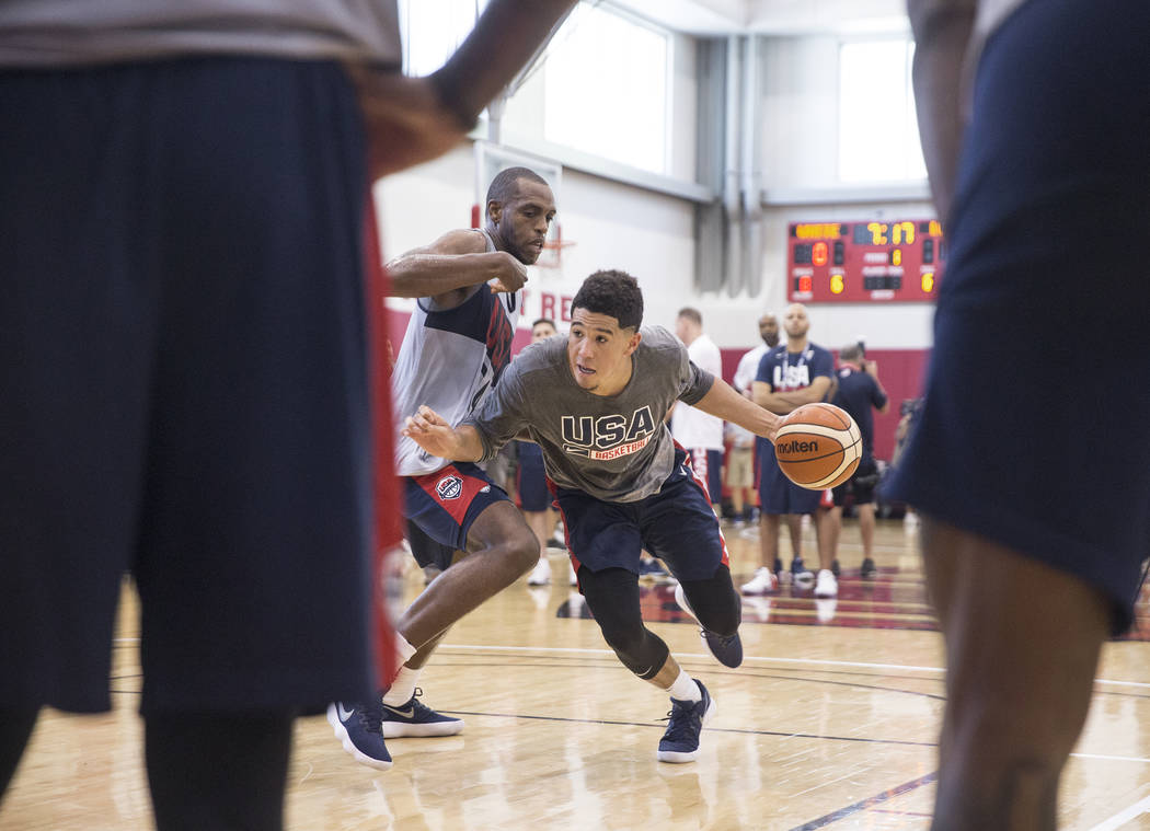 Phoenix Suns guard Devin Booker (31) drives past Milwaukee Bucks forward Khris Middleton (54) during Team USA basketball's minicamp on Friday, July 27, 2018, at the Mendenhall Center, in Las Vegas ...