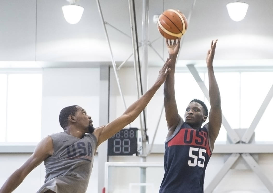 Indiana Pacers guard Victor Oladipo (55) shoots over Golden State Warriors guard Kevin Durant (52) during Team USA basketball's minicamp on Friday, July 27, 2018, at the Mendenhall Center, in Las ...