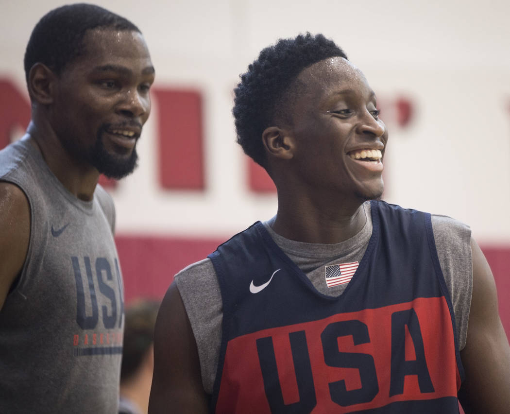 Indiana Pacers guard Victor Oladipo (55) and Golden State Warriors guard Kevin Durant (52) joke around during Team USA basketball's minicamp on Friday, July 27, 2018, at the Mendenhall Center, in ...