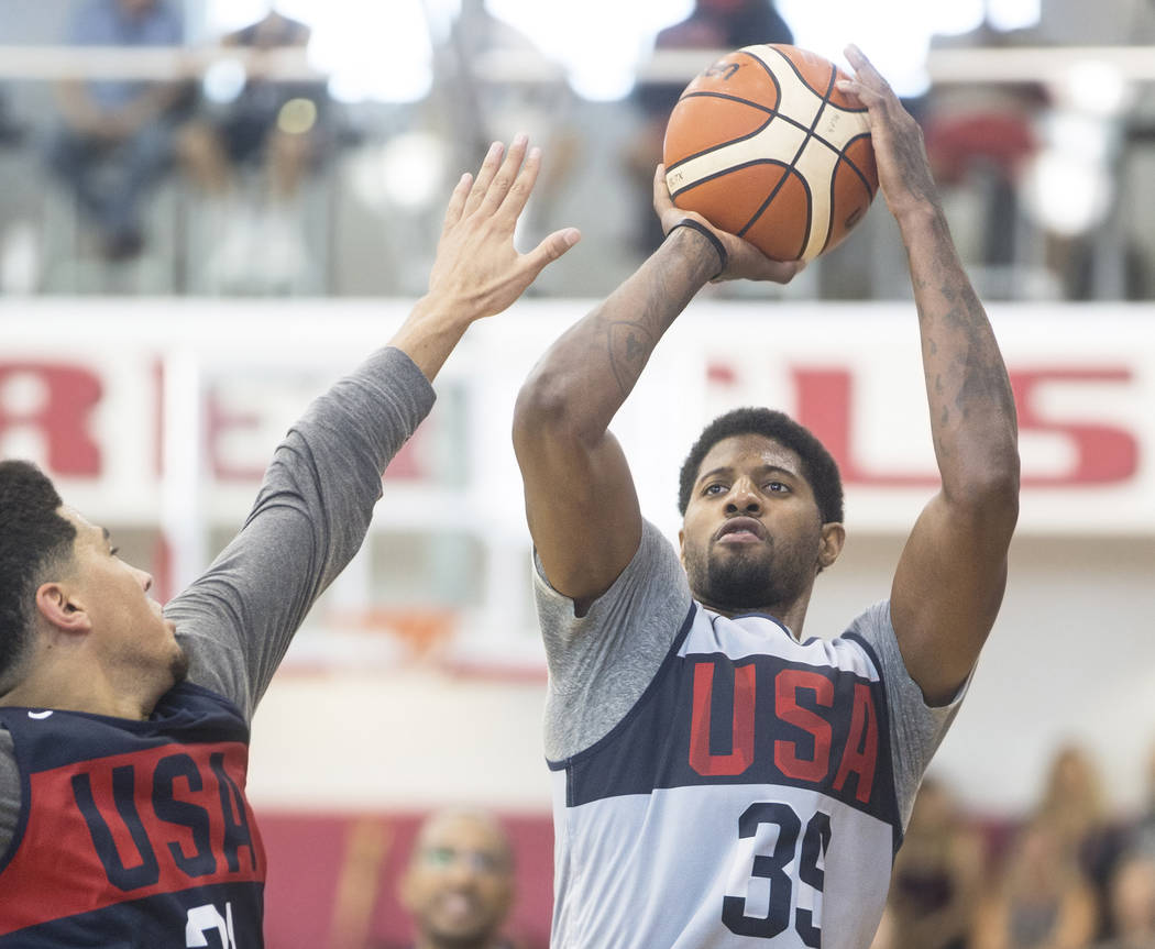 Oklahoma City Thunder forward Paul George (39) shoots over Phoenix Suns guard Devin Booker (31) during Team USA basketball's minicamp on Friday, July 27, 2018, at the Mendenhall Center, in Las Veg ...