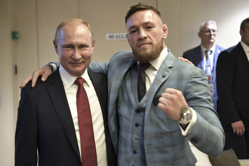 Russian President Vladimir Putin, left, and Ultimate fighting star Conor McGregor pose for a photo during the final match between France and Croatia at the 2018 soccer World Cup in the Luzhniki St ...
