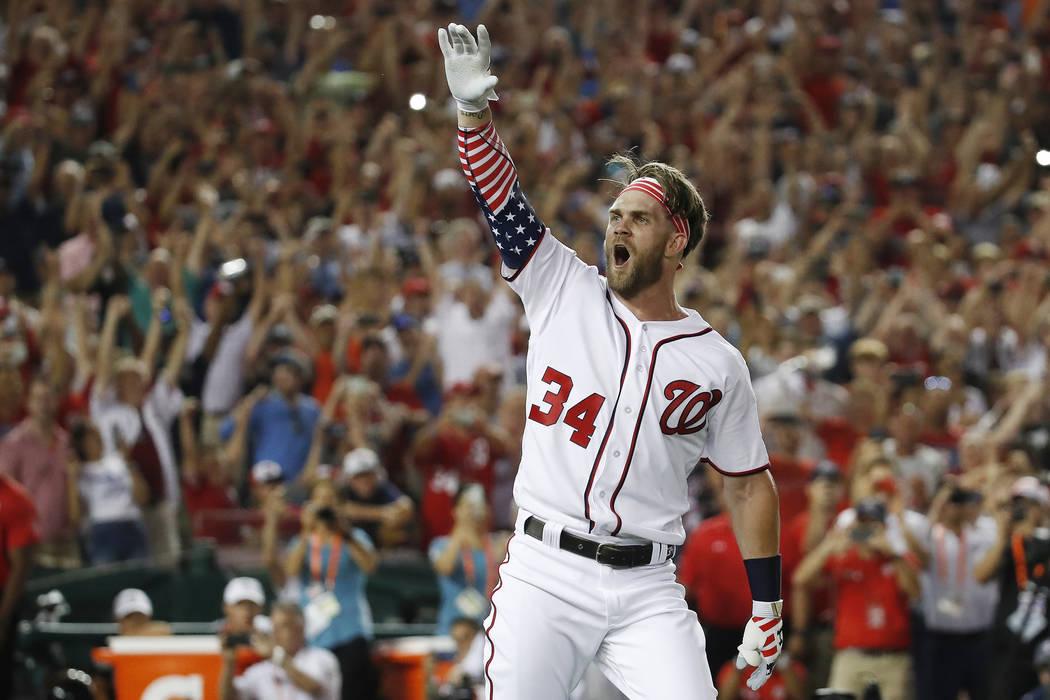 Washington Nationals Bryce Harper (34) reacts to his winning hit during the Major League Baseball Home Run Derby, Monday, July 16, 2018 in Washington. (AP Photo/Alex Brandon)