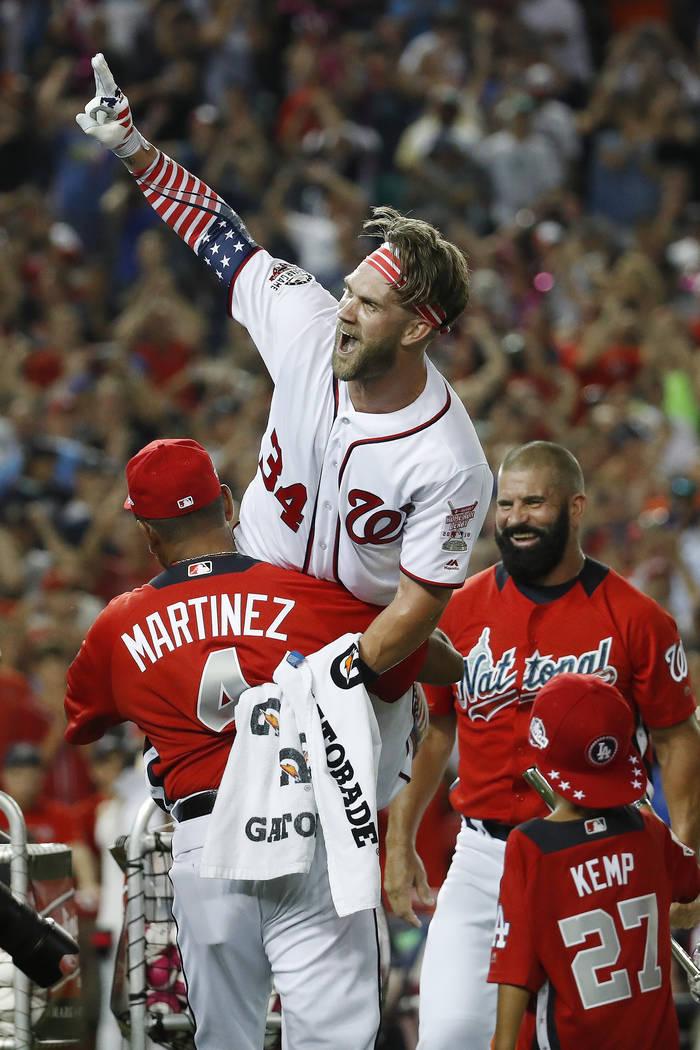 Washington Nationals Bryce Harper (34) celebrates his winning hit during the Major League Baseball Home Run Derby, Monday, July 16, 2018 in Washington. (AP Photo/Alex Brandon)